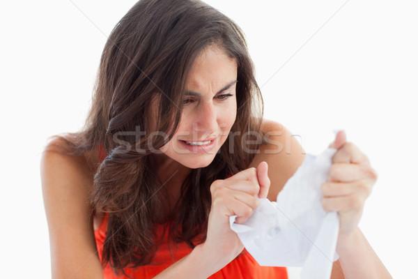 Upset student tearing her homeworks against white background Stock photo © wavebreak_media