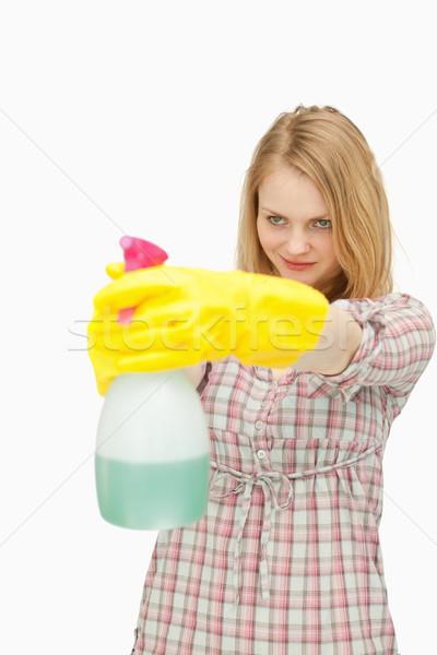 Fiatal nő mosolyog tart spray üveg fehér Stock fotó © wavebreak_media
