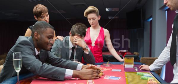 Nők megnyugtató férfi egyéb főnyeremény póker Stock fotó © wavebreak_media