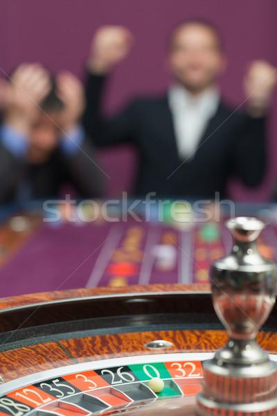 Vesztes nyertes rulett asztal pénz labda Stock fotó © wavebreak_media
