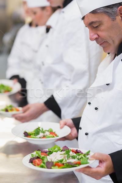 серьезный Повара глядя кухне фон Сток-фото © wavebreak_media