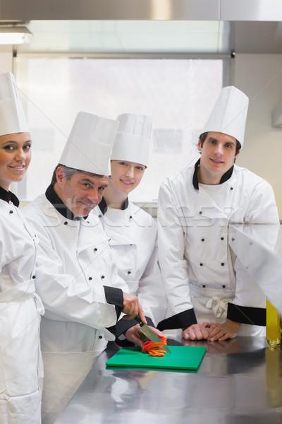 улыбаясь Повара обучения Cut овощей кухне Сток-фото © wavebreak_media