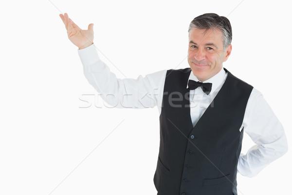 Mosolyog férfi mellény mutat valami levegő Stock fotó © wavebreak_media