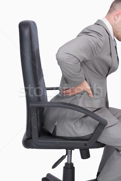 Hombre de negocios dolor de espalda sesión silla de oficina vista lateral blanco Foto stock © wavebreak_media