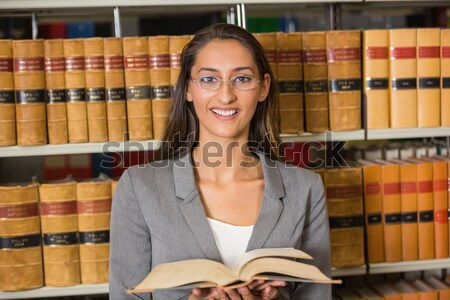 Girl smiling with book Stock photo © wavebreak_media