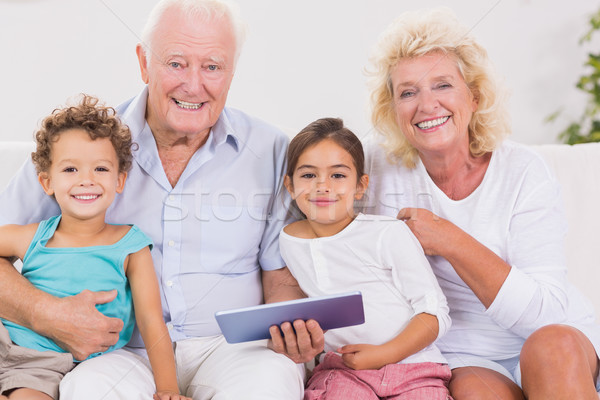 Mosolyog nagyszülők gyerekek táblagép kanapé nő Stock fotó © wavebreak_media