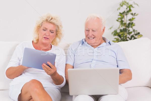 пару используя ноутбук таблетка диван компьютер Сток-фото © wavebreak_media