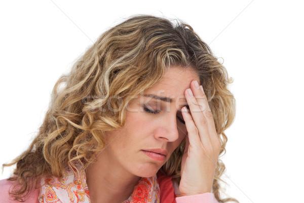 Blonde woman suffering with headache thus holding her head Stock photo © wavebreak_media