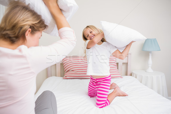 Mother and daughter having pillow fight Stock photo © wavebreak_media