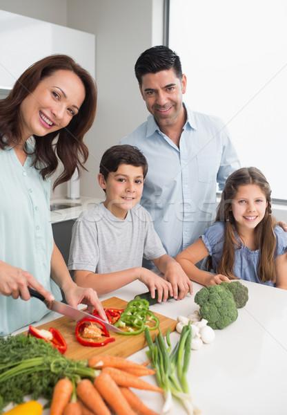 Family chopping vegetables in the kitchen Stock photo © wavebreak_media