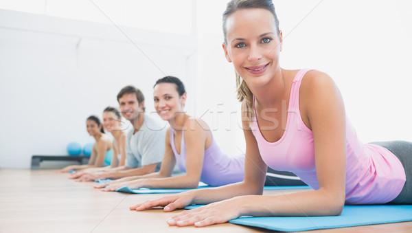 Portrait of fit class exercising at fitness studio Stock photo © wavebreak_media