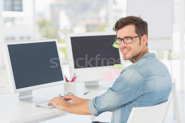 Vista laterale ritratto maschio artista ufficio Foto d'archivio © wavebreak_media