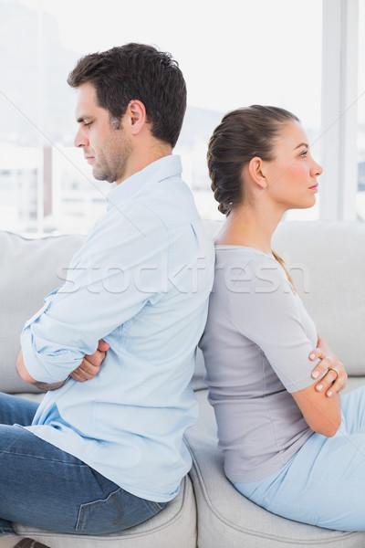 Annoyed couple sitting back-to-back on the couch Stock photo © wavebreak_media