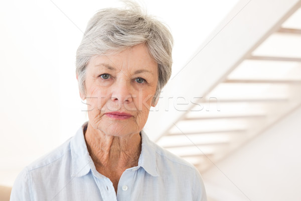 Retired woman frowning at the camera Stock photo © wavebreak_media
