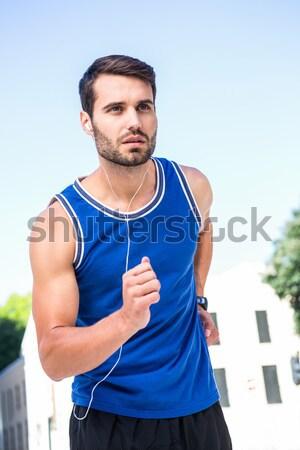 Portrait jeunes homme courir blanche Photo stock © wavebreak_media