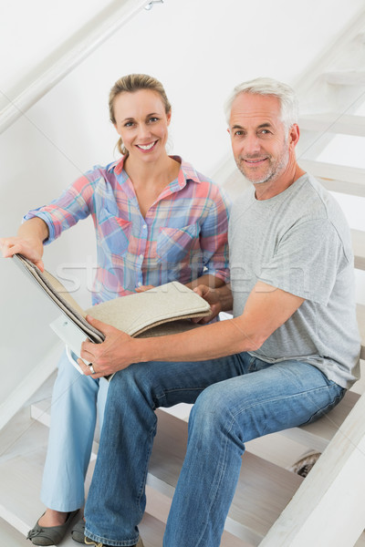 Happy couple picking out carpet samples together Stock photo © wavebreak_media