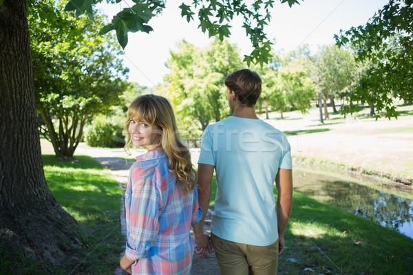Aranyos szeretetteljes pár sétál kéz park Stock fotó © wavebreak_media