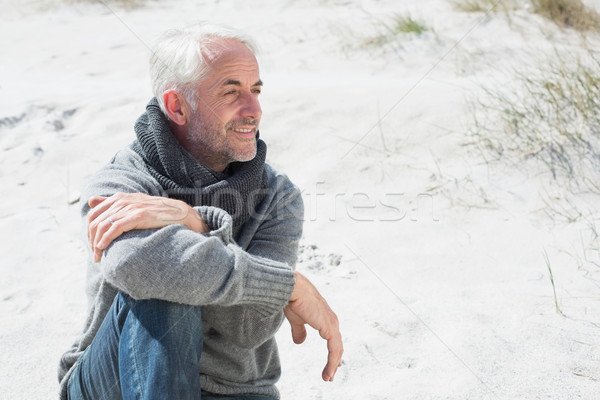 Attractive man smiling on the beach in scarf Stock photo © wavebreak_media