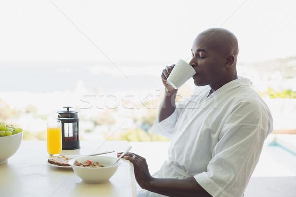 Photo stock: Bel · homme · peignoir · déjeuner · à · l'extérieur · maison