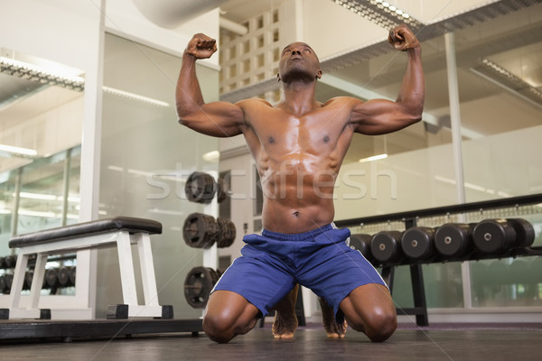 Muscular man flexing muscles in gym Stock photo © wavebreak_media