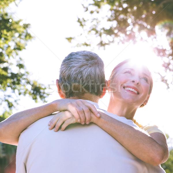 Boldog idős pár átkarol város napos idő tavasz Stock fotó © wavebreak_media