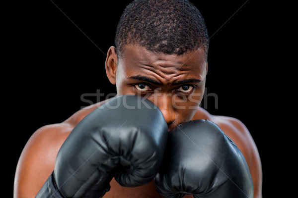 Portrait of a shirtless muscular boxer in defensive stance Stock photo © wavebreak_media