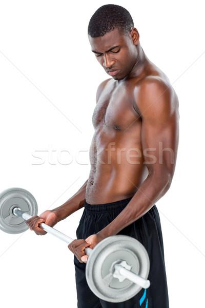 Vastbesloten geschikt shirtless man barbell Stockfoto © wavebreak_media