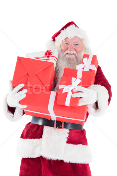 Santa carries a few presents Stock photo © wavebreak_media