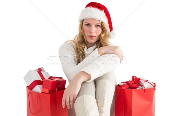 Grave mujer sesión piso bolsa de la compra blanco Foto stock © wavebreak_media