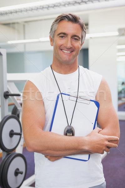 Encajar entrenador personal sonriendo cámara fitness estudio Foto stock © wavebreak_media