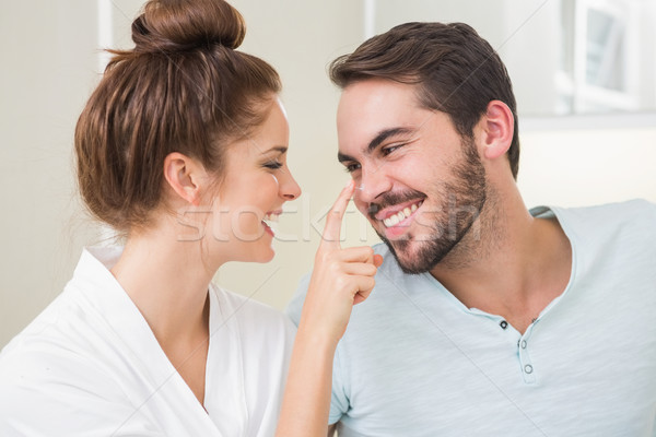 Jeune femme toucher nez maison salle de bain couple Photo stock © wavebreak_media