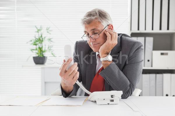 Smiling businessman put on hold Stock photo © wavebreak_media