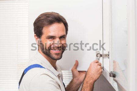 Handyman fixing the cupboard Stock photo © wavebreak_media