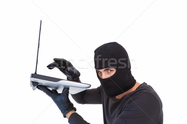 Cambrioleur piratage portable blanche ordinateur Photo stock © wavebreak_media