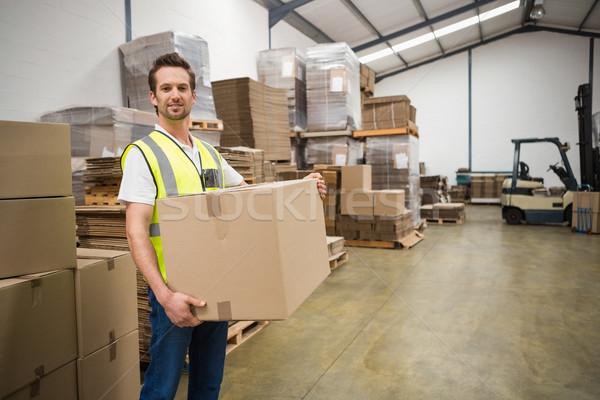 Worker carrying box in warehouse Stock photo © wavebreak_media