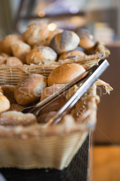 Basket with fresh bread and tongs Stock photo © wavebreak_media