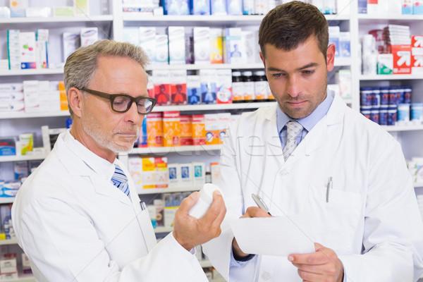 Pharmacist looking a medication for a prescription Stock photo © wavebreak_media