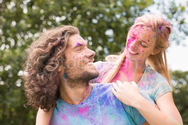 Feliz amigos cubierto polvo pintura Foto stock © wavebreak_media