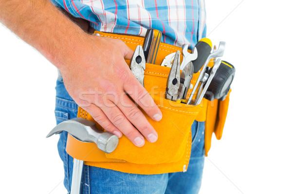 Midsection of handyman wearing tool belt Stock photo © wavebreak_media