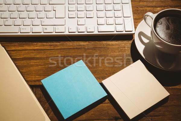 Overhead shot of post its and keyboard Stock photo © wavebreak_media