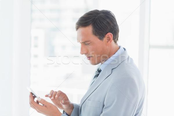 Concentrate businessman using tablet pc  Stock photo © wavebreak_media