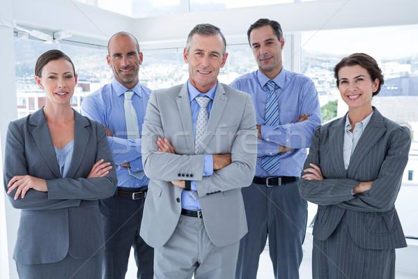 Equipo de negocios de trabajo felizmente junto portátil oficina Foto stock © wavebreak_media