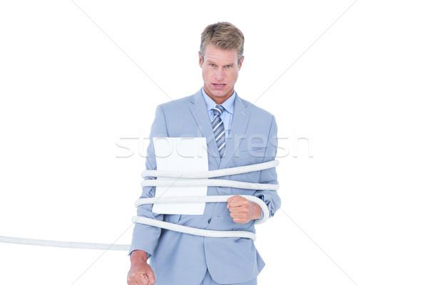 Serious businessman tied up at work Stock photo © wavebreak_media