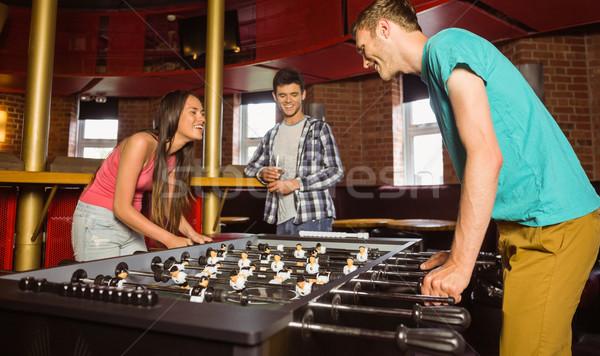 улыбаясь друзей студент играет таблице футбола Сток-фото © wavebreak_media