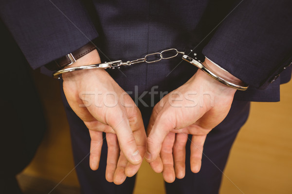 Hands of businessman with handcuffs Stock photo © wavebreak_media