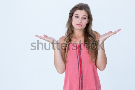 Unsure woman gesturing do not know sign Stock photo © wavebreak_media