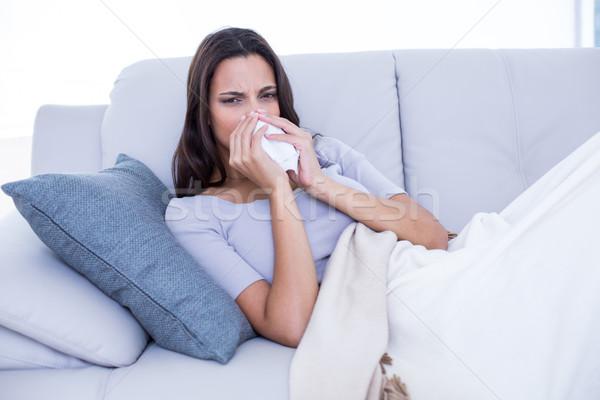 больным брюнетка диване сморкании гостиной домой Сток-фото © wavebreak_media
