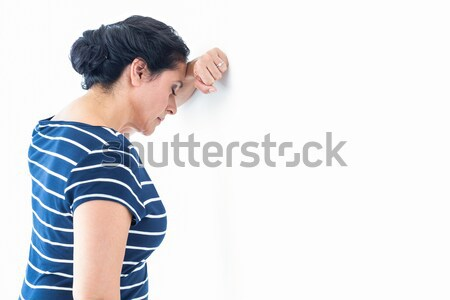 Sad woman leaning against the wall Stock photo © wavebreak_media