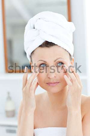 Hand applying eyeshadow to beautiful woman Stock photo © wavebreak_media