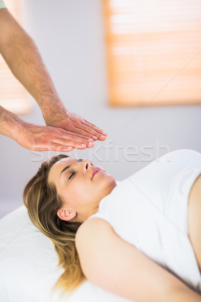 Close up view of pregnant woman getting reiki treatment Stock photo © wavebreak_media